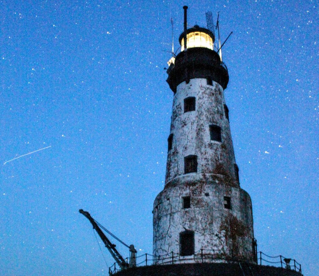 Image of the Rock of Ages Lighthouse at night